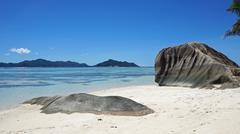 bizarre granite rocks on tropical beachon la digue - stock photo