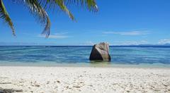 bizarre granite rocks on tropical beachon la digue Stock Photos
