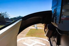 Helicopter landing from cabin. Helipad visible through glass. - stock photo
