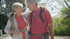 Senior couple walking and talking on trail - stock footage