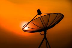 Satellite Dish on the Roof at Sunrise. Stock Photos
