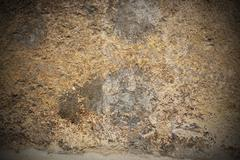 Beautiful ancient stone texture with added vignette Stock Photos