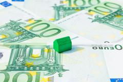 Concept house sell, pay bill, mortgage on 100 euro banknotes. Focus on green  Stock Photos