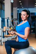Fitness, sports, training, lifestyle - smiling woman with implementation of Stock Photos