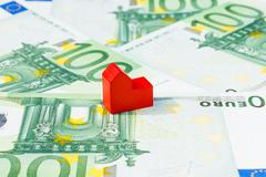 Concept house sell, foreclosure, debt, bill, mortgage on hundred euro banknot Stock Photos