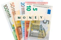 Several euro banknotes. Money of the european union. Text with dice design. - stock photo