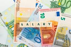 Text salary with background of several euro banknotes. Money of the european  - stock photo