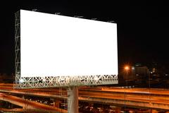Blank billboard at night for advertisement. Stock Photos