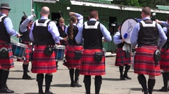 Scottish, Drummer and pipers practicing - stock footage