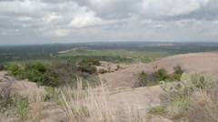 Stock Video Footage of Enchanted Rock Time Lapse 3 Tourists and cactus