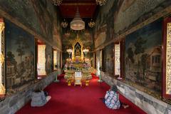 Women praying at buddhist temple Stock Photos