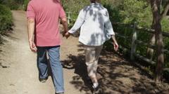 Sweet senior couple walking on trail Stock Footage