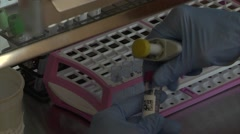 Lab technician with test tubes - close up Stock Footage
