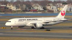 4K Japan Airlines Boeing 787 Dreamliner arrival Stock Footage
