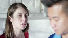 4K Relationship troubles. Portrait of young couple having emotional conversation - stock footage