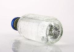 Purified water in a glass bottle - stock photo