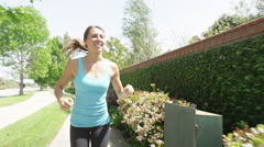 Happy healthy woman running Stock Footage