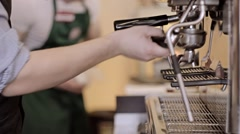 Barista tamping the grind coffee for espresso. Out of focus background Stock Footage