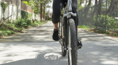 Happy healthy woman riding bike Stock Footage