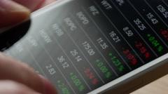 Checking stock market data on smartphone, 4k, UHD - stock footage