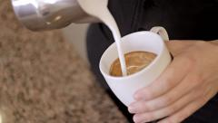 Barista stirs the milk and making cappuccino. Close-Up Stock Footage