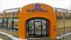 Taco Bell restaurant arch entrance, loop Stock Footage