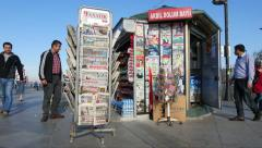 Newspapers and magazines on display at a newsstand Stock Footage
