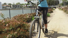 Healthy young woman riding bike - stock footage