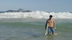 Stock Video Footage of Man walking in sea with surfboard