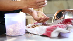 Man cleansing beans with his hands. - stock footage