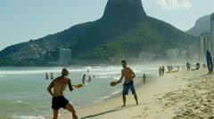 Stock Video Footage of Men playing tennis on Ipanema beach