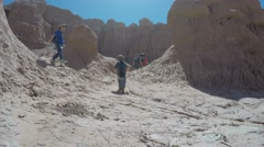 A family in hot Goblin Valley State Park southern Utah Stock Footage