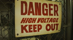 ENTERING A RESTRICTED HIGH VOLTAGE AREA. Stock Footage