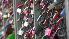 Locks of love hanging on fence 4k Stock Footage
