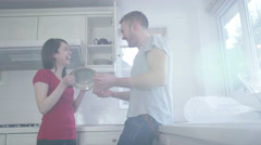 4K Happy young couple packing dishes away in the kitchen of their new home - stock footage