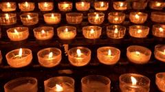 Memory candles burning at church 4k Stock Footage
