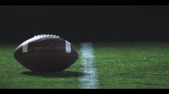Football players line up over ball, SLOW MOTION Stock Footage