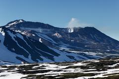 Mutnovsky Volcano - active volcano of Kamchatka Peninsula - stock photo
