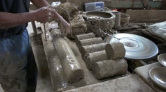 A man cut loaf of clay to mold shapes. Stock Footage