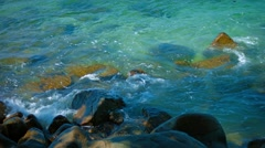 Gentle Waves Wash over Boulders on a Tropical Beach in Thailand Stock Footage