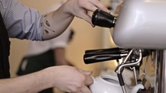Barista pouring hot water into the teapot - stock footage