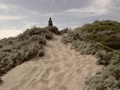 8mm Walking Up a Dune on Beach to Pacific Ocean in California Stock Video Stock Footage