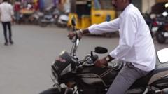 Motorbike and rickshaw India Stock Footage