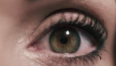 Beautiful woman's eye opening in slow motion - Macro Shot Stock Footage