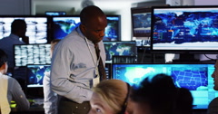 4K Security & surveillance team working in a busy system control room. - stock footage