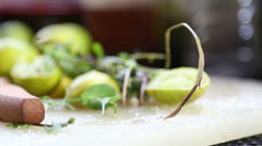 Sliced lime and knife on a chopping board. Stock Footage