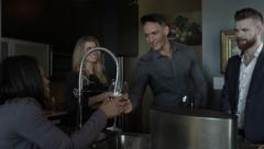 Young People drinking wine - party at a high end condo Stock Footage