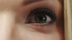 Beautiful young woman's eye close up - 4K Ultra High Definition Stock Footage