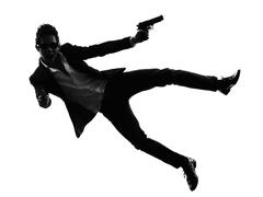 asian gunman killer jumping shooting  silhouette - stock photo