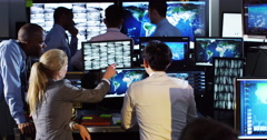 Stock Video Footage of 4K Security & surveillance team working in a busy system control room.
